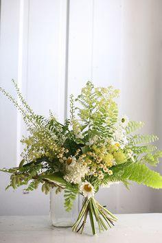 A #summerwedding bouquet with ferns | Brides.com