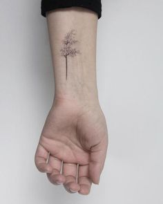 Hand poked windy tree tattoo by Lara M.J.