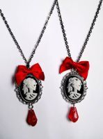 skull lady cameo necklaces by GothicLucia