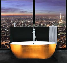Gold leaf clad freestanding bathtub and a view to match its opulence!