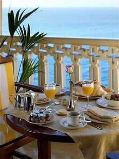 No idea where this is but I sure would love to sit down for that breakfast and look at that wonderful view!!