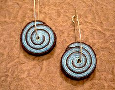 These one of a kind spiral earrings really make a statement!! Each spiral is shaped by hand from genuine Italian leather. Enjoy these playful pieces