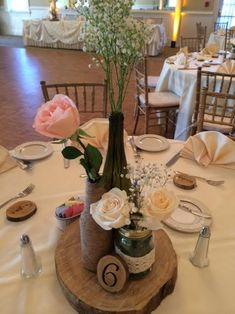 Loved these cute homemade rustic centerpieces by my November bride. Beer bottles wrapped in twine, mason jars with chunky lace wrap, and empty wine bottles stuffed with baby's breath and roses.