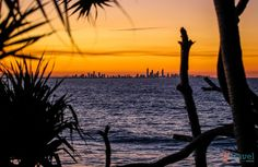 Sunset over Surfers Paradise, Gold Coast, Australia Coolangatta to Point Danger Walk (Just before sunset, grab dinner at Rainbow Bay Surf Club)