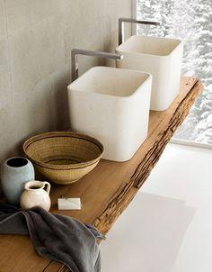 sink basins atop wood slab counter