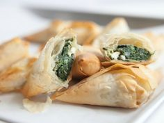 Spinach Feta Triangles : Flaky phyllo is always a crowd-pleaser, especially when filled with savory feta and hearty (and virtuous!) spinach. These homemade versions of the freezer-aisle appetizers bake up in just 15 minutes.