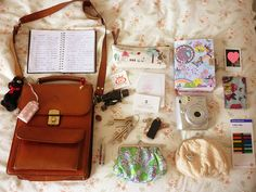 inside my purse by the wandering witch girl, via Flickr