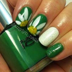 White flowers on green base (Pure Ice 'Free Spirit') nail art design