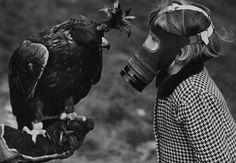 1939- England. Child wearing gas mask. History history