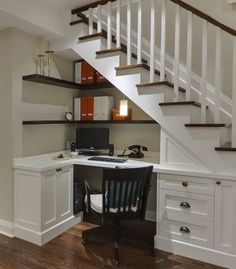 Home office space neatly tucked under a stair.