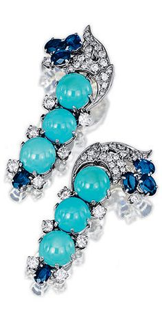 TURQUOISE, SAPPHIRE AND DIAMOND PENDENT EAR CLIPS, 1970S A pair of pendent ear clips set with cabochon turquoise, oval sapphires and brilliant-cut diamonds, mounted in white gold.