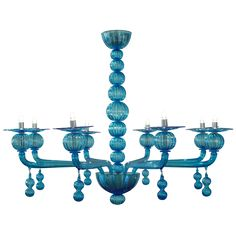 There is nothing like brightly colored glass -- Aquamarine Murano Glass Chandelier by Barbini -- a real piece of jewelry!
