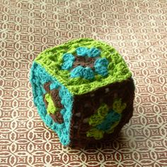 Soft baby toy cube in retro style granny squares multi color. $15.00, via Etsy.