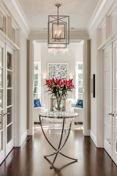 Beautiful hallway, french doors, mirrored side table, fresh flowers, square pendant lighting | KL Interiors