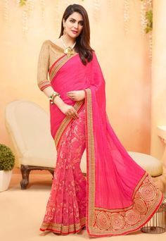 Pink Golden Designer Party Wear Saree in poly georgette is beautified with embroidered floral motifs and foliage patterns on the saree that enhances its look. Embroidered foliage patterned border patch completes the look of an Indian women.