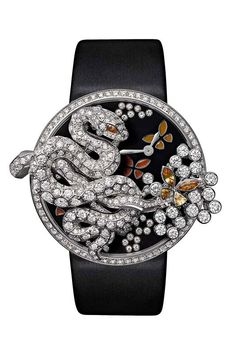 @Cartier Fabuleux snake watch, a numbered edition limited to 60 pieces. Case in white gold set with brilliant-cut diamonds.