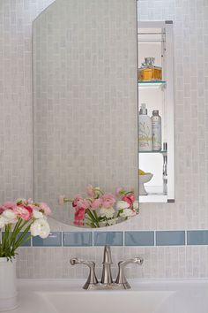 Karrara mosaic tiles and blue celetial glass tile accents