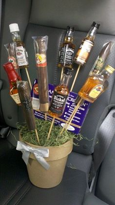 "Found the photo for a ""Man's Bouquet"" pre wedding favor sent to the man's room?! Hrmm! Maybe one bottle for each man, plus tick tacs and tissue, could double as an emergency kit."