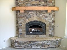 Love this corner one with the hearth seat, only would use a darker stain on the mantle