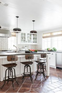 D Home | White-on-white kitchen at Kay and Greg Potter's Fort Worth lake house. Light fixtures from Parkhouse Antiques. Stools from Restoration Hardware. Tiles and countertops from Walker Zanger.
