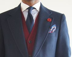 Navy sport coat, white shirt with light blue dress stripes, navy knit tie, red sweater, olive khakis