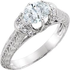 69821 / 14K White / ENGAGEMENT / SEMI-MOUNT WITH HEAD / 07.00X05.00 MM CENTER STONE / Polished / NONE