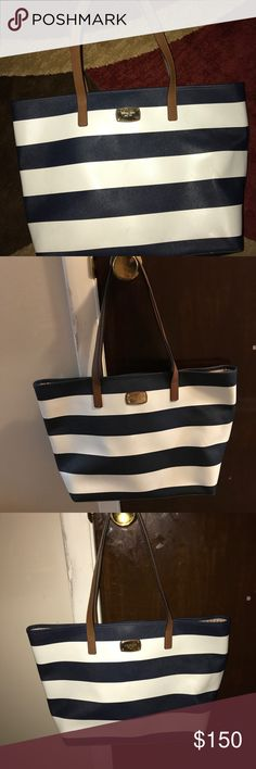 Michael Kors Jet set navy striped tote L Gently used Authentic Michael Kors Jet set navy striped tote in L. Brown straps. Very minor black mark on the front that can probably be wiped away 😀 hard to find Michael Kors Bags Totes