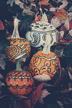 I decorated these pumpkins with paisley patterns a few years ago with sharpie and a silver paint pen. They turned out beautifully and were perfect for Halloween and just general fall decorations.