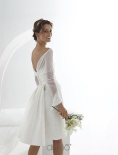 Le Spose di Giò...Cute. Adjust the length to fit your wedding theme. Cheaper to have custom-made than purchasing from salon.