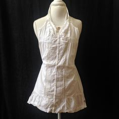 Hollister White Summer Dress This is a light, white Hollister summer dress, with details of buttons down the center, lace down the center, and a cute embroidered hem. The straps cross in the back. Excellent condition no rips stains or holes Hollister Dresses Mini