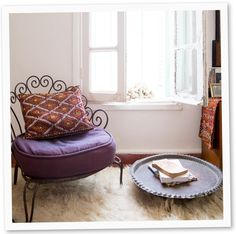 A plush wool rug creates  a cozy spot for relaxing  with a good book | domino.com