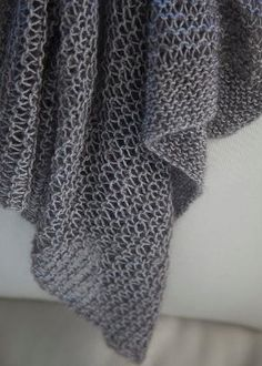 LottieDa's Drop Stitch Scarf.   Other pinned said: Cast on 70 st. With 13 needle. 20 rows of grater. Then with 11 needles .Row 1: K1 yo, repeat to end. Ending with a k sts. 2nd row k1, drop all yo & K the K sts. to end. Keep repeating both rows. I just knitted till I had enough yarn to do garter. Knit garter with 13 needles at bottom, same as other end. Bind off! by Mi55Mollie