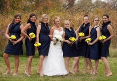 Jill & Her Girls wearing deep navy dresses with yellow wedding bouquets - a perfect pallet for late summer. Flowers by Jenny Thomasson AIFD CFD of Stems Florist, St. Louis, MO www.stems4weddings.com