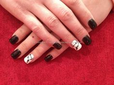 Full set of acrylic nails with black and white gel polish with cross chain as nail art