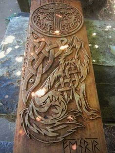 Wolf and crow carved knotwork panel