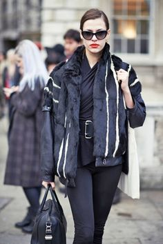 A red lip is even more vibrant when worn with a black and white ensemble #streetstyle