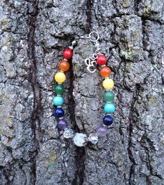 Chakra Healing Semi-Precious Stone Bracelet with Om Charm on Etsy, $19.99