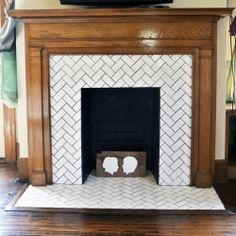 before & after herringbone tile fireplace renovation in a 1918 bungalow master bedroom