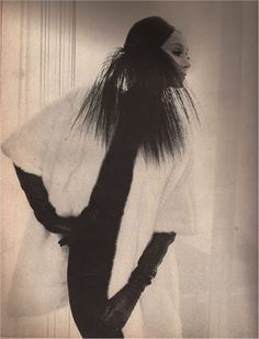 At Night - The Intrigue of Opulent Furs  White bands of Mink by Alixandre  Mr. John's chic black faille hat  Gleb Derujinsky
