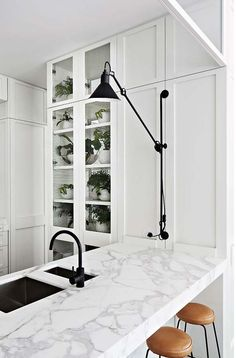 An incredibly elegant, light, modern kitchen, rendered lively with just the right amount of black from a black sink, black faucet (Dornbracht's Tara) and that gorgeous black lamp. From a Melbourne home designed by Hecker Guthrie (via Apartment Kitchen Interior, New Kitchen, Kitchen Ideas, Kitchen Designs, Country Kitchen, Vintage Kitchen, Ugly Kitchen, Marble Interior, Cheap Kitchen