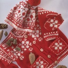 Knitted Scandinavian style red and white cardigan set.