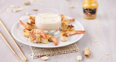 These peanut crusted gambas get a crunchy crust from peanuts and Asian-inspired flavor using coconut milk and mustard with white wine, mangoes, and Thai spices for an appetizer you can make again and again for any occasion!