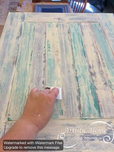 Layering paint colors with a hotel key card or credit card to create this rustic, chippy look.  Artistic Home Studio & Boutique, Alameda, CA.