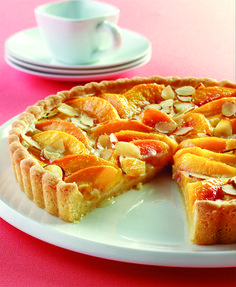 This delicate peach tart combines an almond-flavored crust with fresh peaches, cream and sliced almonds.