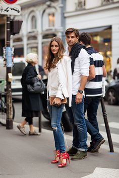 Olivia Palermo simple and chic in jeans, white too, and red satin heels