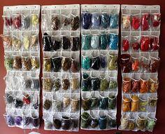 shoe organizers for wool storage...by Lilfish studios.  Wool storage. Fiber Art Studio Organization Ideas.