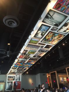 A cool ceiling at Red Robin that displays photos and paintings as if they were hung on a wall