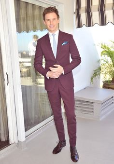 Mr Redmayne at an event by Vanity Fair and Burberry celebrating the BAFTA and Britannia Awards, Los Angeles, 29 October. Plum, oxblood, pale blue and a vibrant flash of kingfisher pocket square combine to create an outfit that has absolutely no right to work as well as it does.   MR PORTER