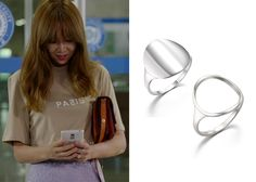 Ji Hae-Soo (Gong Hyo-Jin 공효진) wears a 14K white gold round ring and a silver circle ring during the bus stop scene at the end of Episode 6 of It's Okay, That's Love. They are the J.Estina Mystère Rond Gold # 1 Ring and the J.Estina Mystère...
