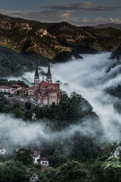 ~~Covadonga ~ mysterious s-shaped band of mist surrounds the iconic basilica in the Picos de Europa, Cangas de Onís, Asturias, Spain by wilsonaxpe~~